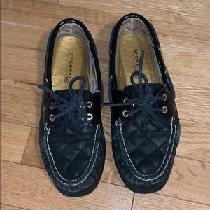 Sperry's black and gold shoes